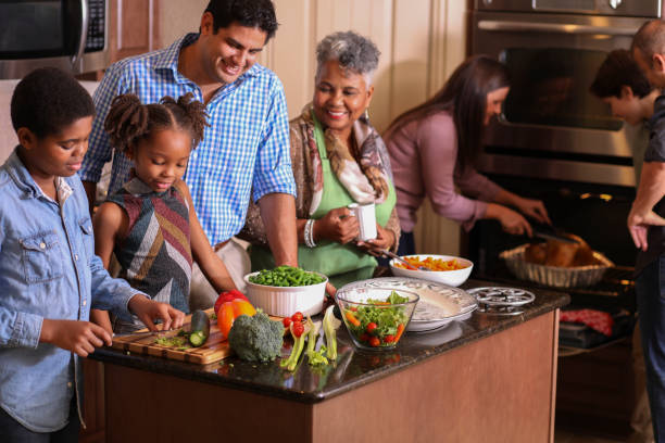 diverse family in home kitchen cooking thanksgiving dinner. - christmas cooking imagens e fotografias de stock