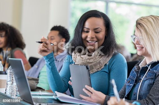 istock Diverse female college friends use digital tablet in class 639615984