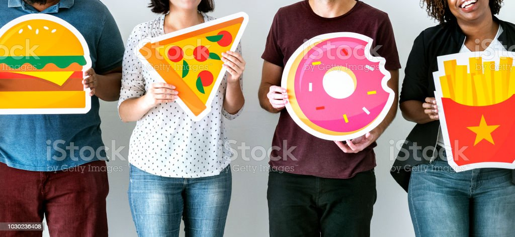 Diverse friends with food icons stock photo