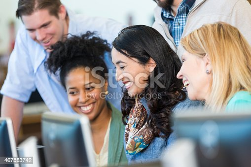 877026364 istock photo Diverse group of adults continuing education in library computer lab 467583742