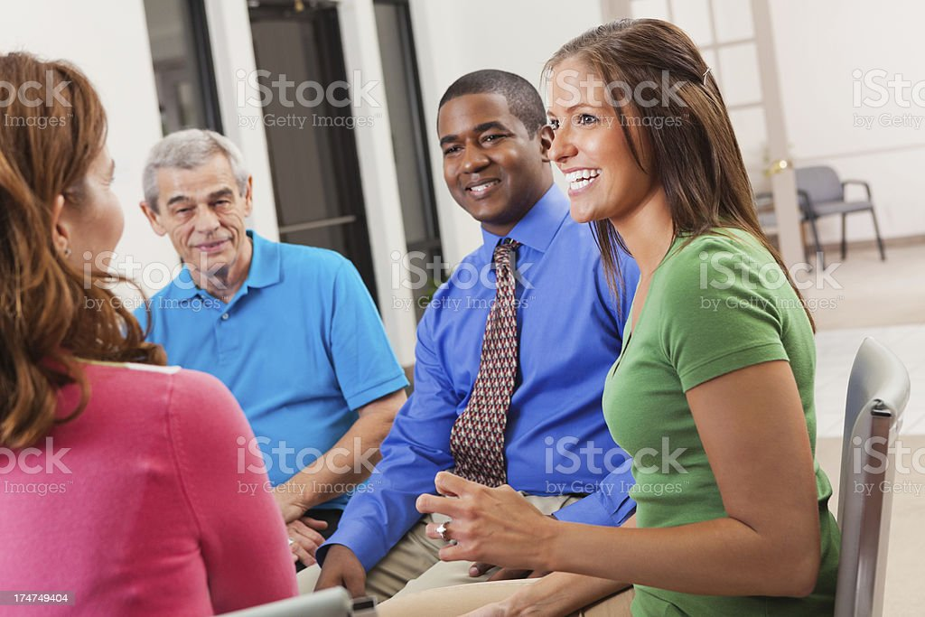 Diverse group of adults discussing something in support meeting royalty-free stock photo
