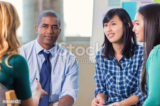 istock Diverse group of adults in support group 508485402