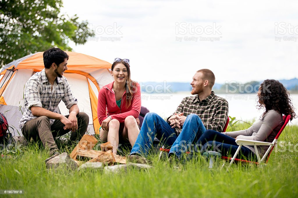 Diverse Group Of Adults Telling Stories Around A Campfire Royalty Free Stock Photo