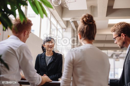istock Diverse group of business people having meeting 612849124