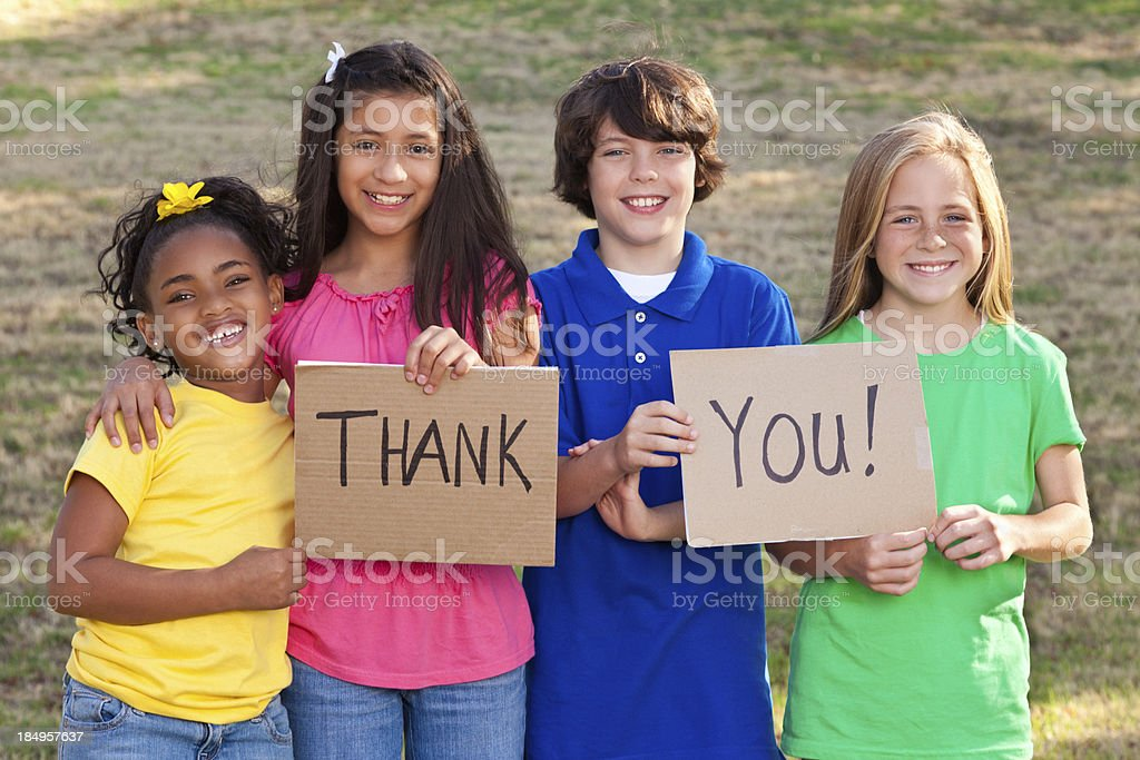 Diverse group of children holding Thank You signs stock photo