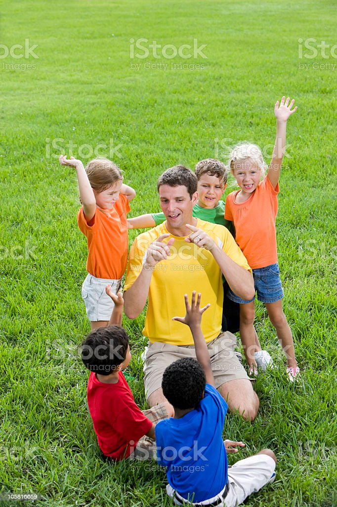 Diverse group of children with summer camp counselor royalty-free stock photo