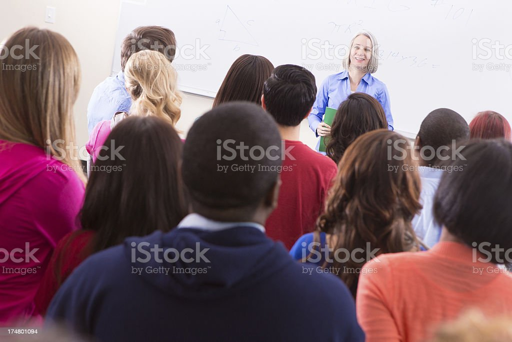 Diverse group of college students listening intently to professor's lecture royalty-free stock photo