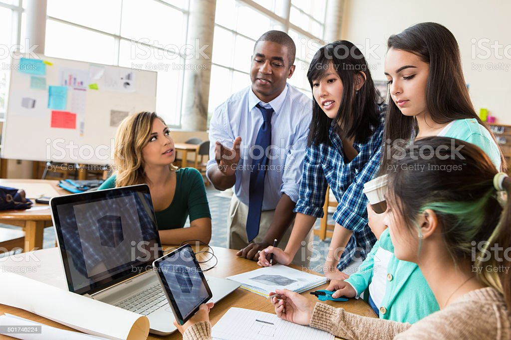 Diverse group of creative professionals discuss ideas in modern office stock photo