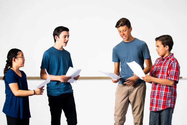 diverse group of drama students practicing play - audition stock photos and pictures