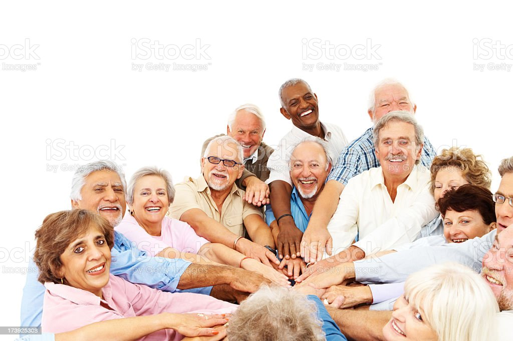 Diverse group of elderly with hands in middle of circle royalty-free stock photo