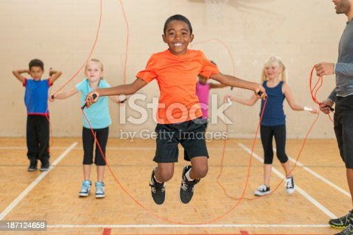 istock Diverse group of elementary children jumping rope 187124659