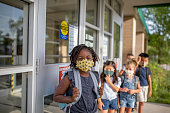 istock Diverse group of elementary school kids go back to school wearing masks 1270794789