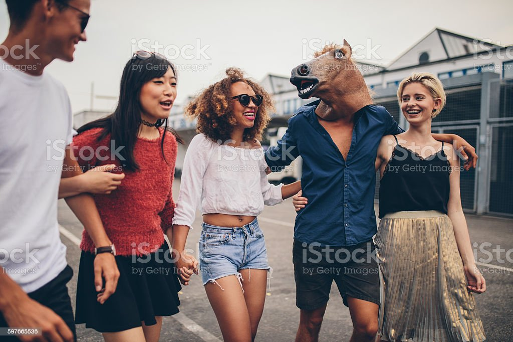 Diverse group of friends having fun outdoors stock photo