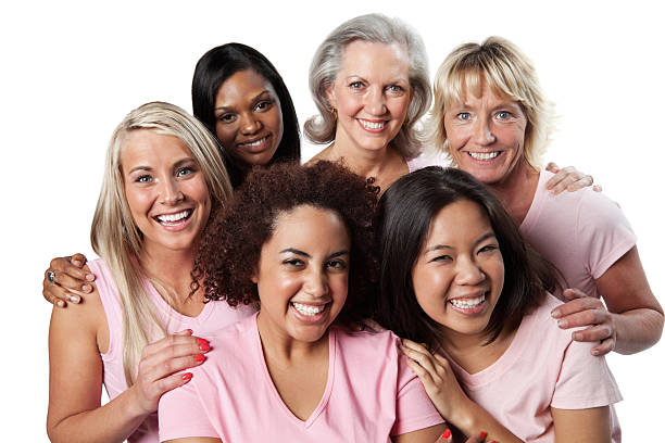 Diverse group of happy women in pink stock photo