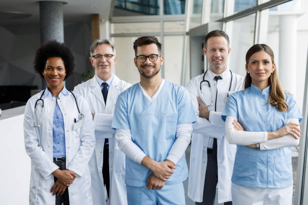 Diverse group of hospital doctors, surgeons, and nurses stock photo