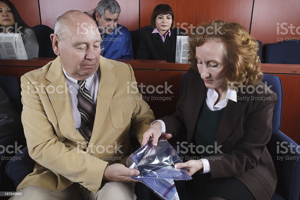 Diverse Group of Jurors Looking at Evidence royalty-free stock photo