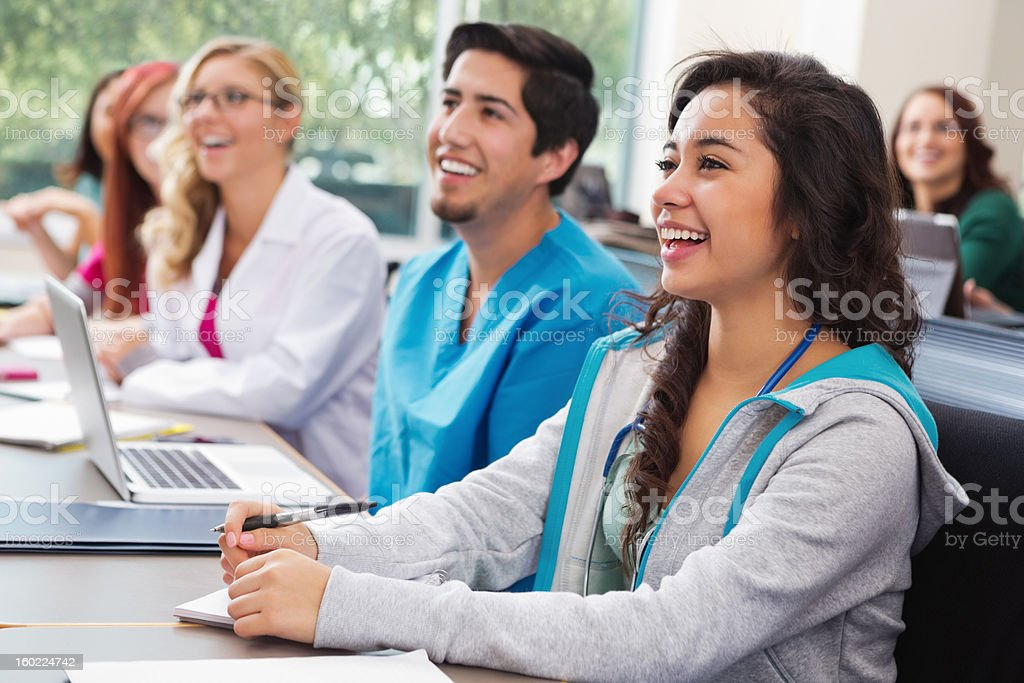 Diverse group of medical or nursing school students in classroom royalty-free stock photo