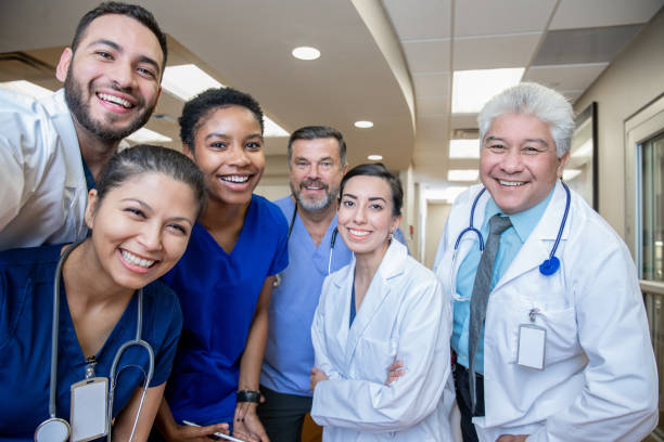 Diverse group of medical professionals smiling together stock photo