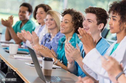 istock Diverse group of medical student applaud professor 637181822