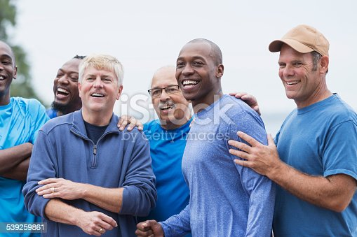 istock Diverse group of men standing together 539259861