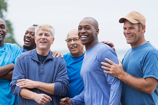 Diverse group of men standing together stock photo