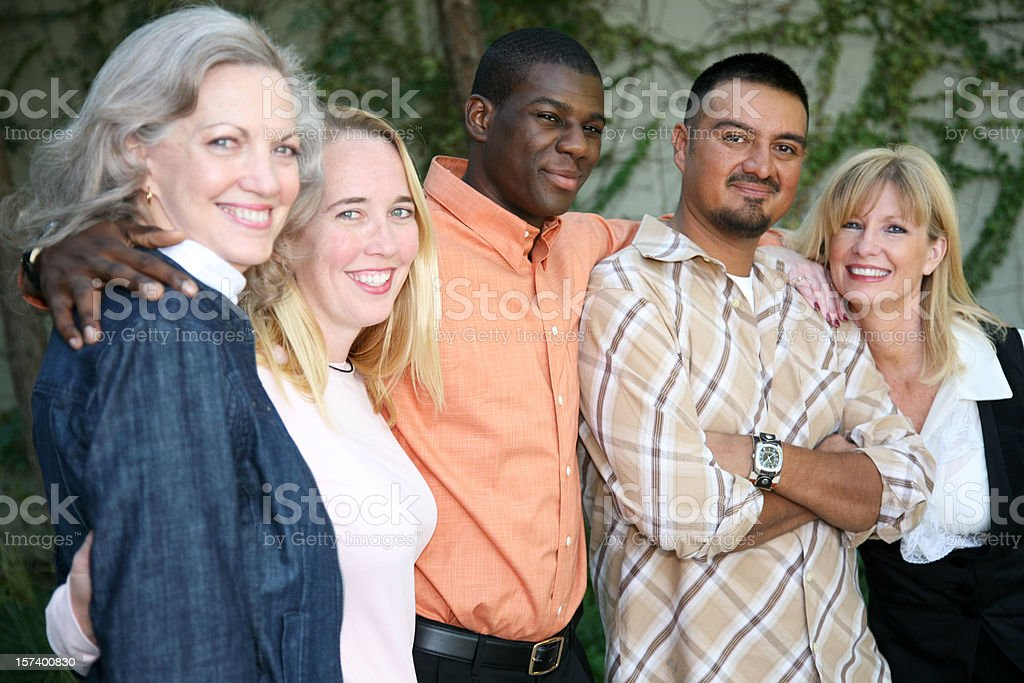 Diverse Group Of People Embracing And Smiling Together royalty-free stock photo
