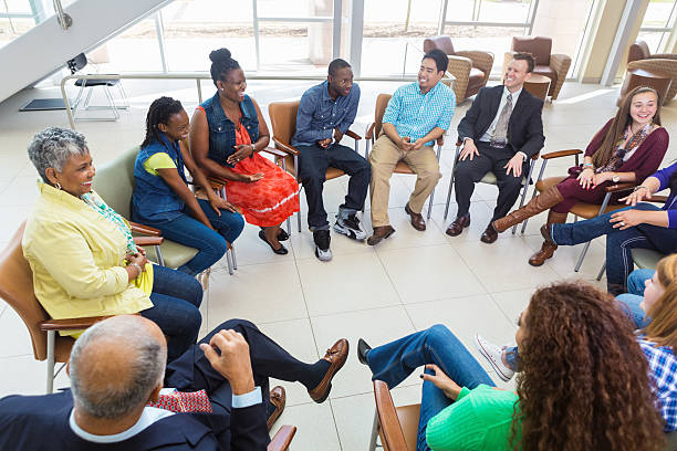 Diverse group of people in a meeting together stock photo