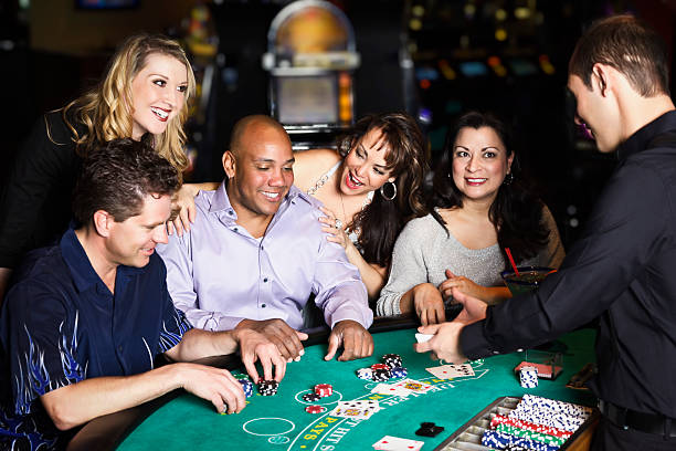 diverse group of people playing blackjack in a casino - black jack bildbanksfoton och bilder