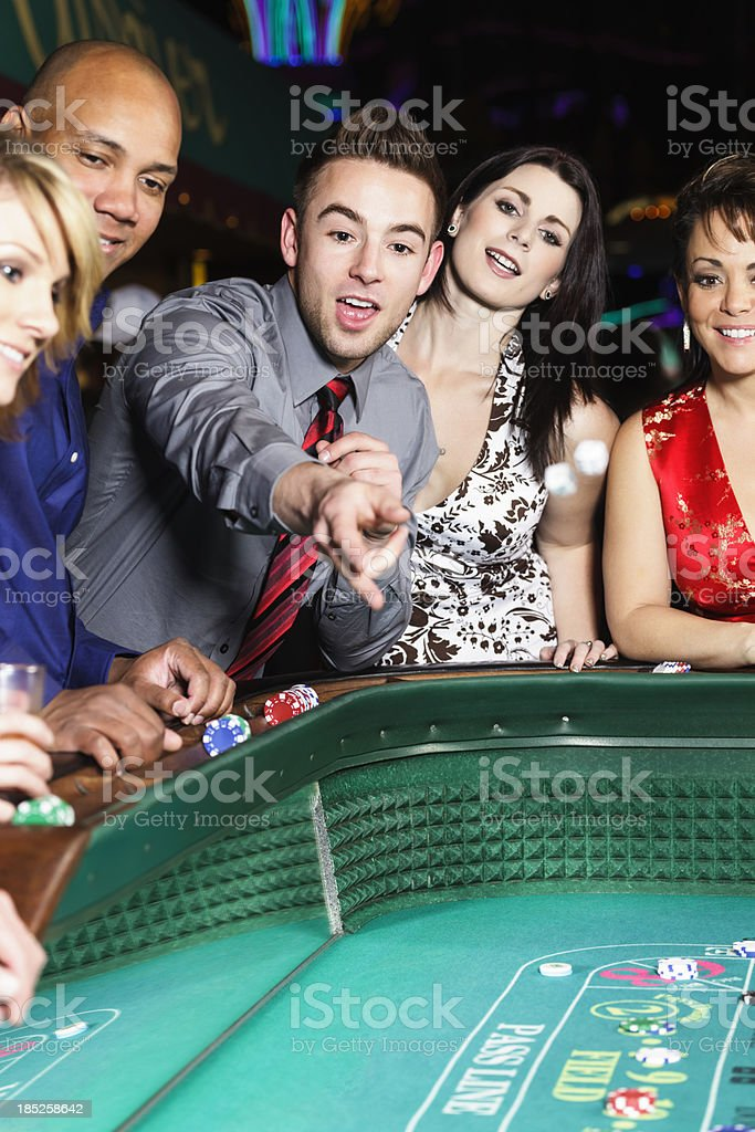 Diverse Group of People Playing Craps In Casino royalty-free stock photo