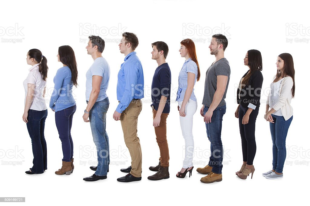 Diverse group of people standing in row stock photo