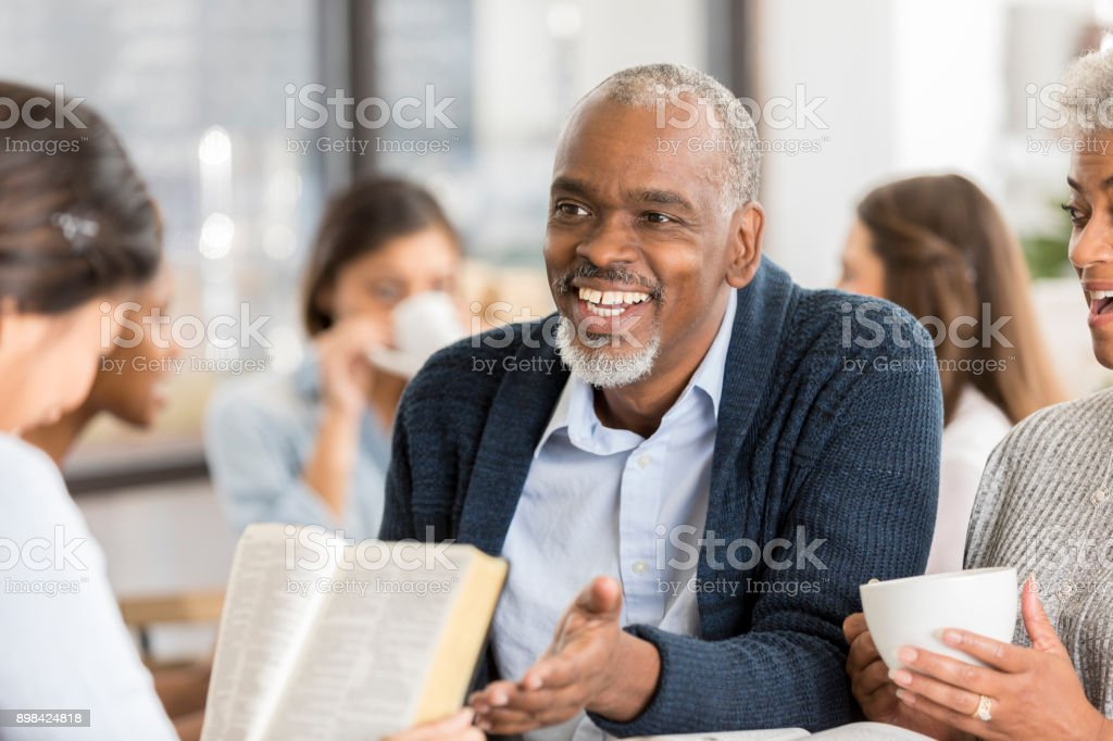 Diverse group of people studying the Bible stock photo