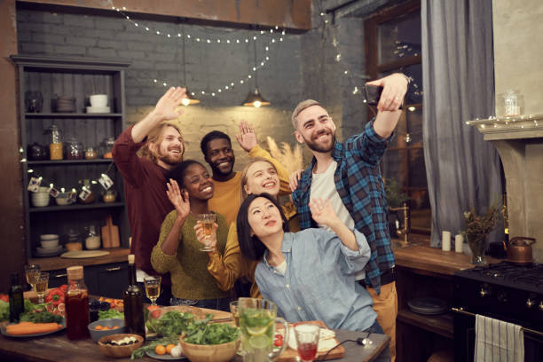 diverse group of people taking selfie at party - family gatherings stock pictures, royalty-free photos & images