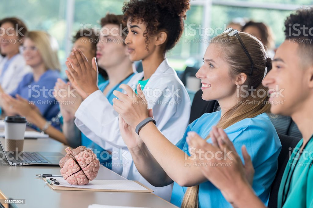 Diverse group of pre-med students applaud in class stock photo