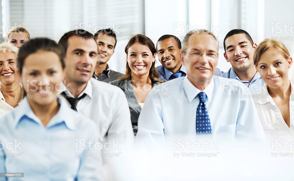 Diverse group of professionals smiling royalty-free stock photo