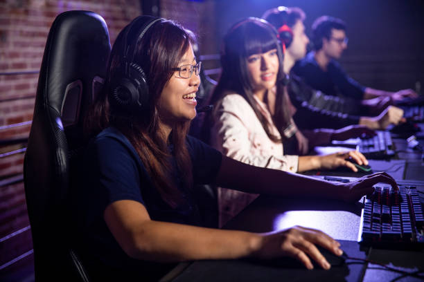 diverse group of students playing esports - esports stock photos and pictures