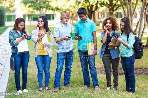 143071438 istock photo Diverse group of students using smart phones on college campus 520508749