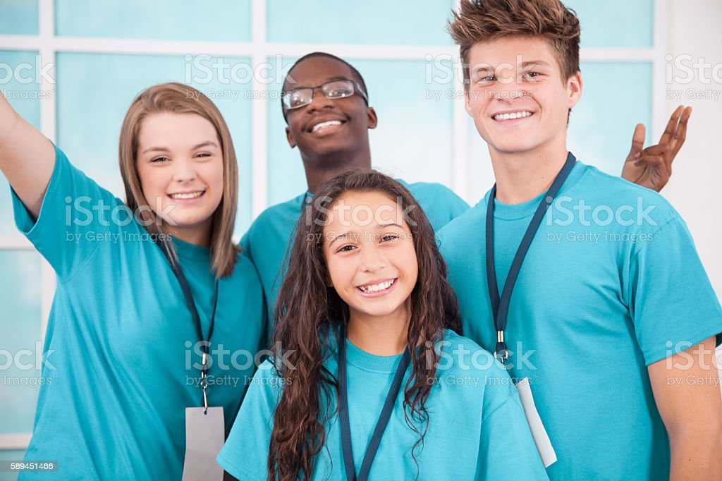 Diverse group of teenage volunteers. stock photo