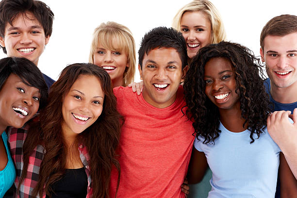 Diverse Group of Teenagers - Isolated Group of diverse teenagers posing together and smiling for the camera. Horizontal shot. Isolated on white. teenagers only stock pictures, royalty-free photos & images