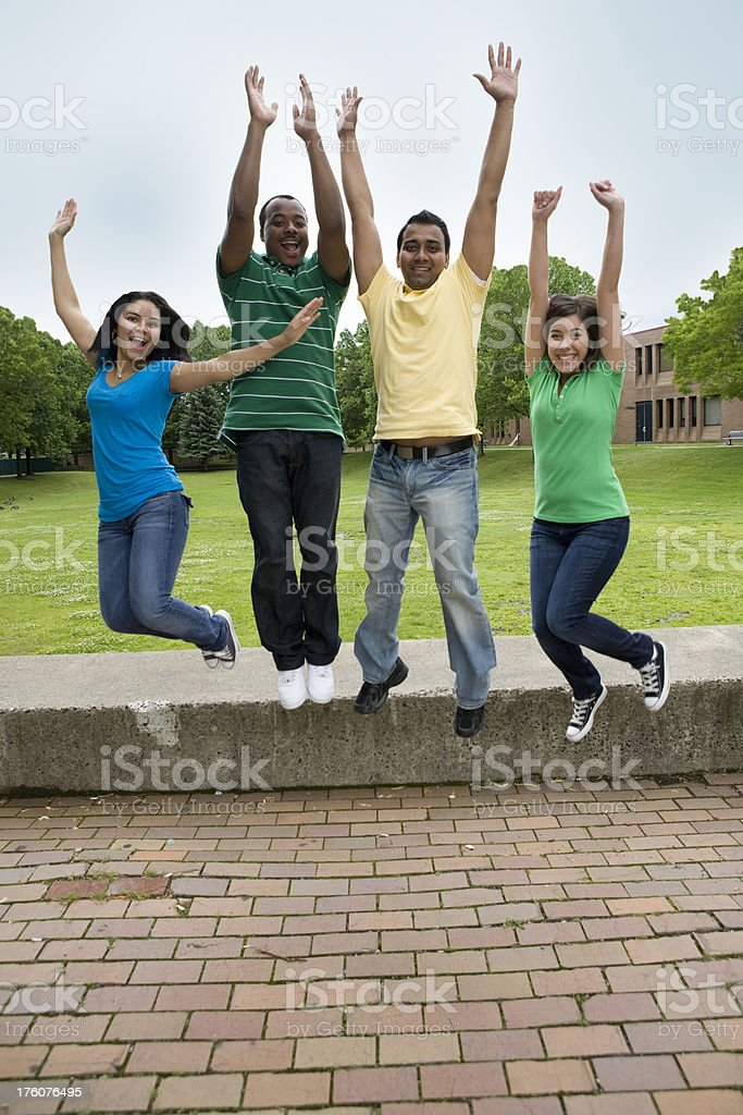 Diverse Group of Teens Jumping For Joy royalty-free stock photo