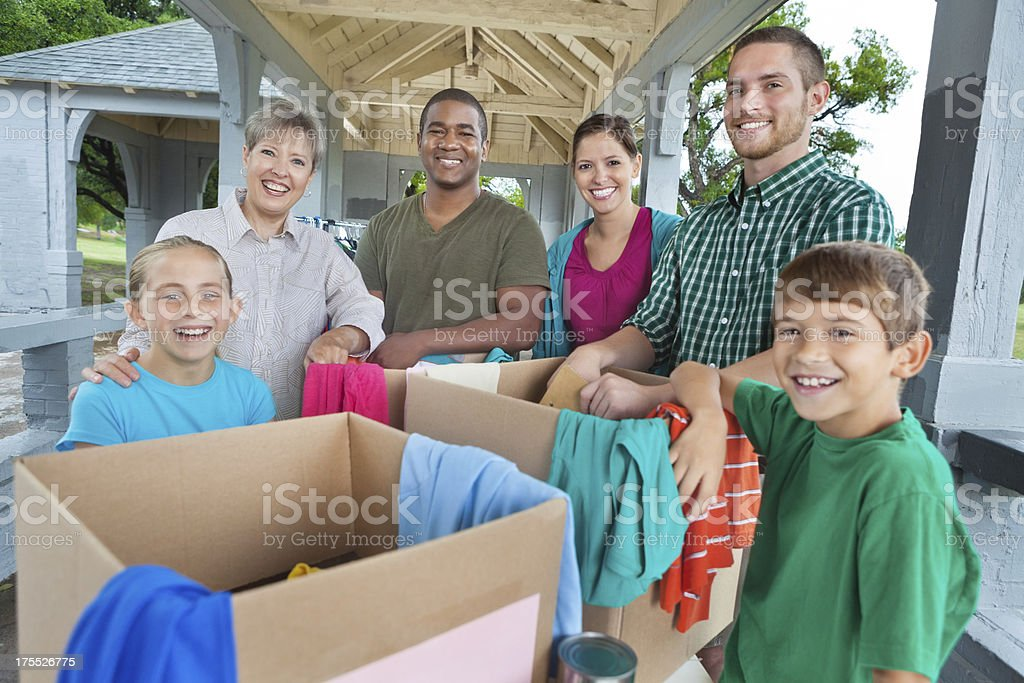 Diverse group of volunteers at clothing donation charity drive royalty-free stock photo