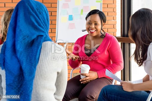 istock Diverse group of women in colorful clothes at the meeting 993970024