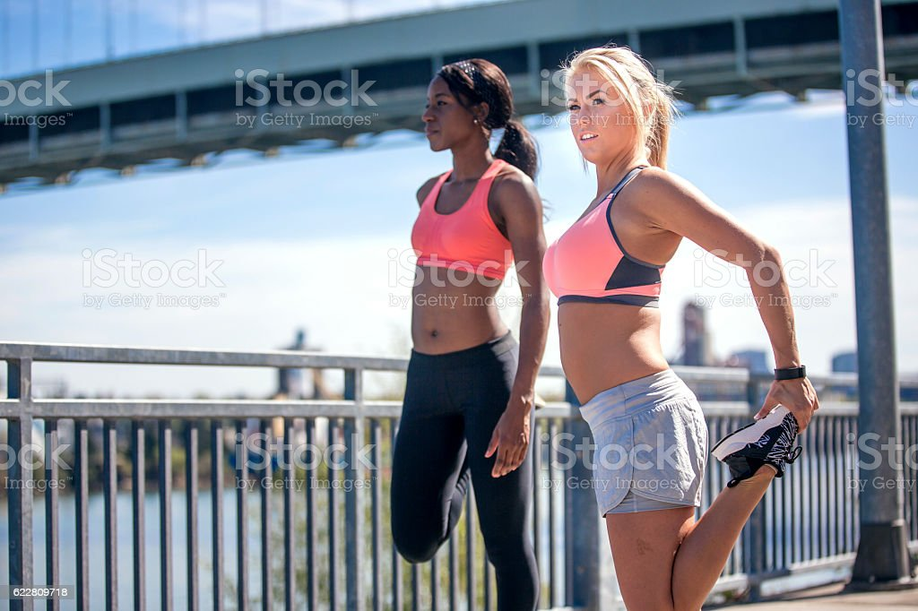 Diverse group of young adult females stretching stock photo