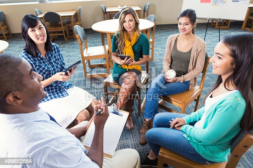 istock Diverse group of young adults in meeting or support group 499652884