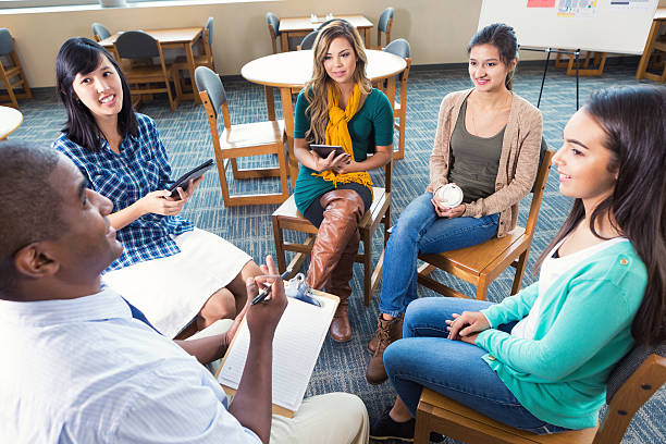 Diverse group of young adults in meeting or support group stock photo