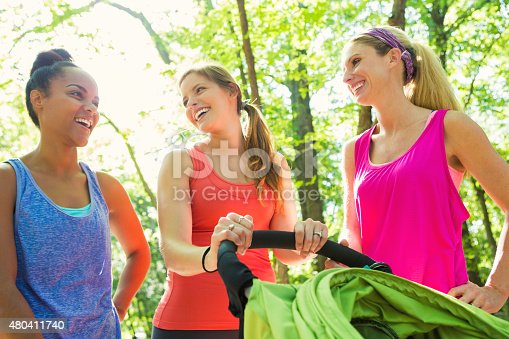 istock Diverse group of young moms exercising together in park 480411740