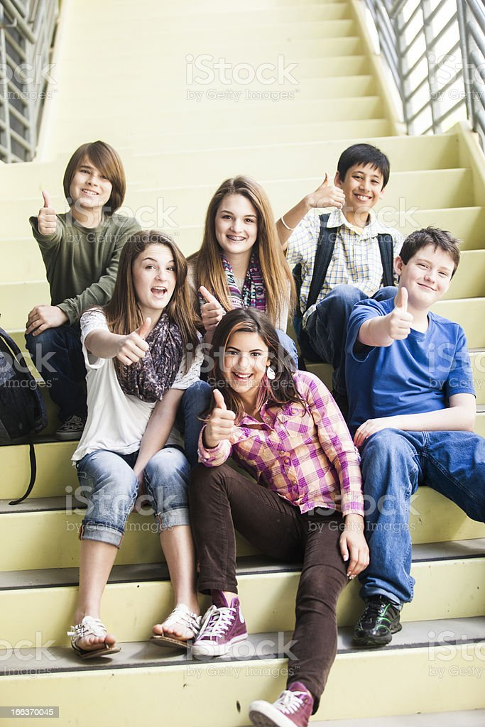Diverse Group of Young Students Thumbs Up royalty-free stock photo