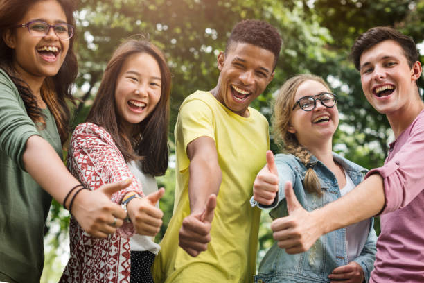 diverse group young people thumb up concept - teenager stock photos and pictures
