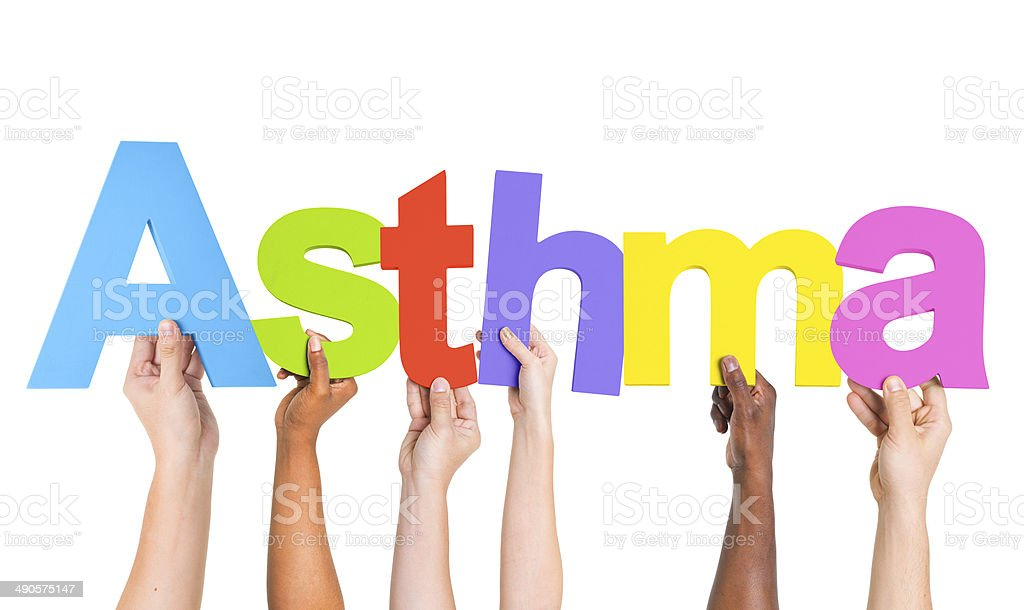 Diverse Hands Holding The Word Asthma stock photo