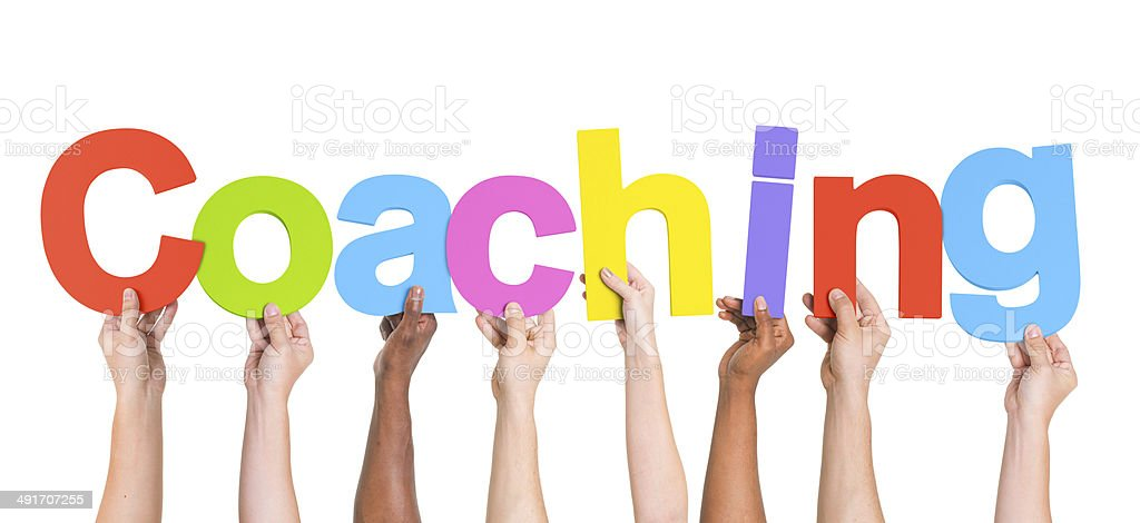 Diverse Hands Holding The Word Coaching stock photo