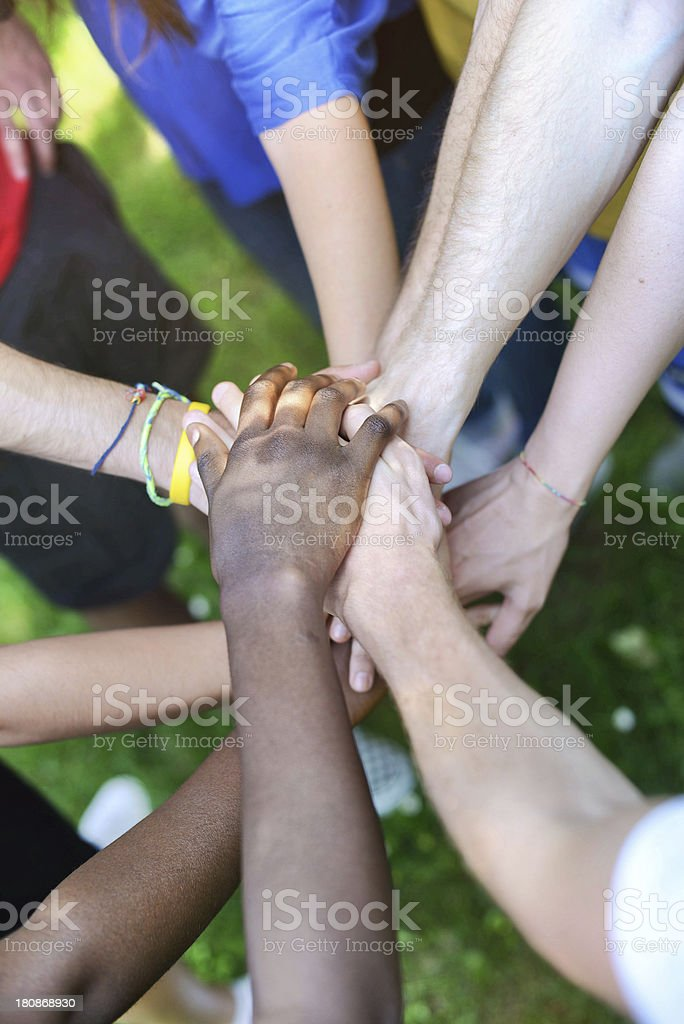 Diverse hands together outdoors royalty-free stock photo